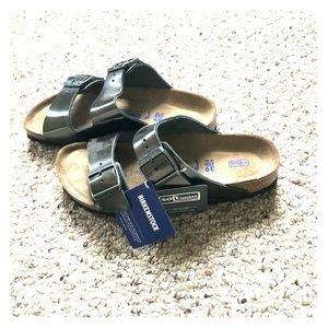 Never worn gray metallic Birkenstock sandals
